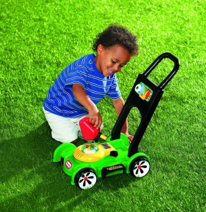 Child with toy lawn mower