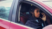 Youth on phone in car